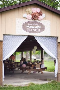 Vintage Pony Party: decorate a picnic shelter with a custom printed sign (vinyl if possible, in case of rain) + lace curtains + tissue paper pom flowers