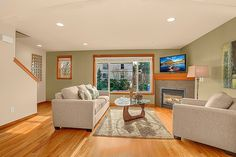 Transitional Living Room with High ceiling, metal fireplace, Carpet, Mercury Row Aries Sofa by Serta Upholstery