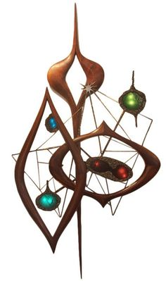 Phillip Lloyd Powell and Paul Evans; Walnut, Metal and Glass Wall Sculpture light, 1950s.