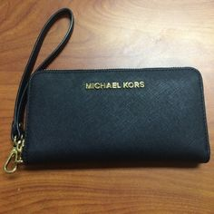 Michael Kors wristlet Michael Kors black wallet wristlet, gold hardware. Has 3 ID/ credit card slots, zip pocket for coins and change, and another long pocket. Has space for your phone and is sooo convenient. I ❤️❤️❤️ this wallet and I promise you won't be disappointed. I bought from nordstroms for Myself and I've only used it a few times (less than 5) PERFECT CONDITION. 100% authentic Michael Kors Bags Clutches & Wristlets
