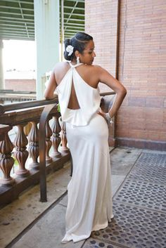 """The Dress Switch: When it was time to party with their guests, Dayna swapped out her ceremony gown and slipped into this  elegant Nicole Miller dress. """"I felt like a true bride in my first dress and a sexy bride ready to party in my second one,"""" admits Dayna (from essence.com's Bridal Bliss with Dayna & Ryan)"""