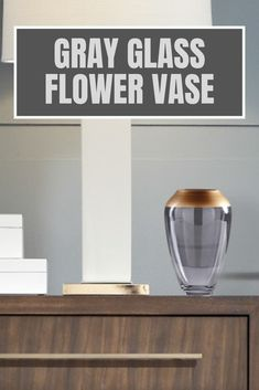 Painted gray glass flower vase is an unforgettable gift idea for your friends, family members or yourself. Glass vase of flowers is also a valuable addition to the existing modern home decor collection and a perfect start of a new one. Vintage glass flower vase brings a modern touch of minimalistic simplicity to your living room, foyer or office. Choose a centerpiece ceramic flower vase to celebrate housewarming, anniversary, birthday or any other special moment. #flowervase #vase #glassvase