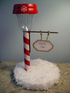 North Pole made out of solar light from dollar store. Kids would love this for their room. I want to make the Christmas one, and a black one, so it looks like an old fashioned street light, with interchangeable signs. it could be used year round, spanish moss, and have little flowers, or clovers, or spiders/pumpkins… an every day decoration! The possibilities are endless, and I am in love.
