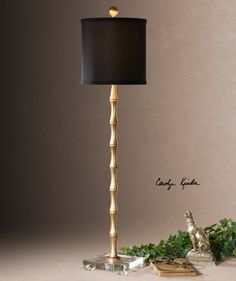 Quindici Item #29585-1  Metal bamboo finished in a lightly antiqued gold leaf accented with a crystal foot. The round hardback drum shade is a crisp black linen fabric.  Designer:	Carolyn Kinder Wattage/Bulb Type:	100W, ON-OFF # of Bulbs:	1 Dimensions:	37H,   Shade 9 Dia. (in) Weight (lbs):	9 Ship Via UPS:	Yes UPC Number:	792977295854