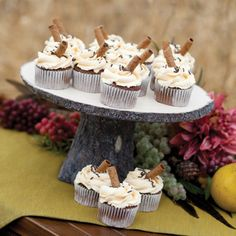 Rustic Log Wedding Cake Stand with cupcakes. The shape and style of a real wood cake stand w/o the hassle of bark falling off and other cleanliness issues associated with using real wood.