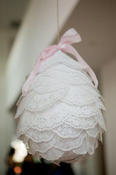 interesting look...a doily? covered balloon.