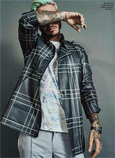 Posing for a new photo shoot, J. Balvin sports a Prada jacket, Diesel t-shirt, and his own trousers.