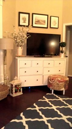 makes sense to find a dresser for the tv to sit on... more storage space for extra things.