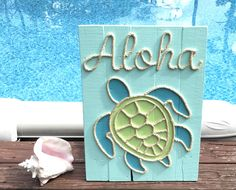 A personal favorite from my Etsy shop https://www.etsy.com/listing/536877583/handmade-aloha-turtle-with-rope-beach