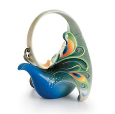 """Peacock Teapot - FRANZ PORCELAIN Peacock Splendor TEAPOT . Size 9-1/4 x 8-1/4 x 9 -1/2"""" Franz porcelains capture cultural, artistic, and fashion elements.Franz Porcelain is created using the finest Chinese clay and glaze."""