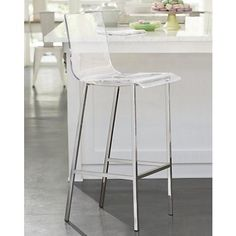 A clear seat paired with chrome finish creates a chic, modern look for your home bar.