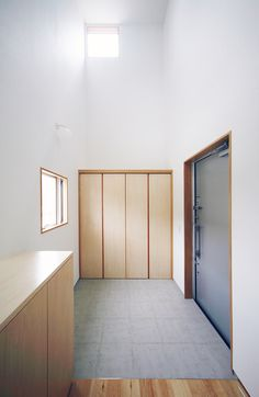 House in Kosai, Japan by Shuhei Goto Architects is divided into four house-shaped towers