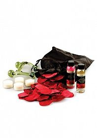 A Bed of Roses Deluxe Edition  For couples falling in love, already in love or celebrating many years of love, a Bed of Roses Deluxe is the perfect compliment for a romantic getaway. Whether at home or away, this gift will transport you and your lover to a place of romantic pleasure. Inside the sexy black satin pouch you will find a special invitation card, four tealights, rose-scented bubble bath, warming massage oil in chocolate, a hand held massager and over 250 scented red silk rose…