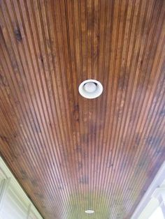 Beaded pine wood ceiling panels for porch.