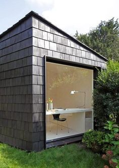 Garden Studio by Serge Schoemaker Architects. This garden studio features a plywood-lined interior and is covered in cedar shingles.