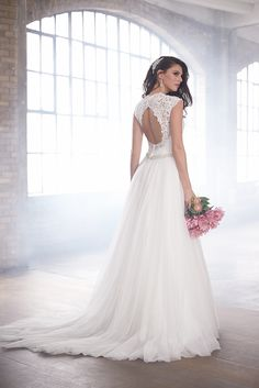 Lace and cap sleeves and beautiful tulle combine beautifully in this Madison James dress. @weddingwire