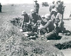 Uknwown date and location; Argentinian Soldiers training with a mortar.Notice…