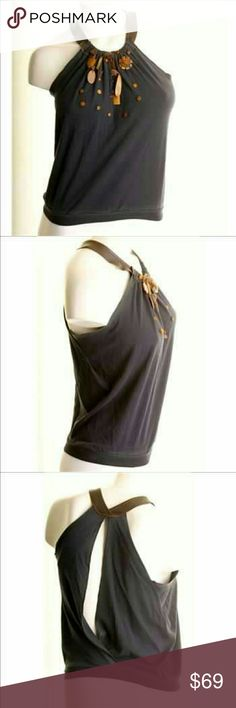 """Rozae Nichols Navy Wood beaded tank, small Rozae Nichols Navy split Open Back Tank w wooden beads & pices/fringe  Very unusual top!  Size Small (fit medium too)   This Navy Open Back Tank features wooden bead deco,  split open back & leatherette shoulder straps.   This piece measures 18"""" flat - up to 36"""" around bust (comfortably) and is 23"""" in length.   Pre-loved, see lower left front banded hem for slight fading.   100% cotton. Hand wash  Make an offer! rozae nichols Tops Tank Tops"""