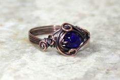 Blue Wire Wrapped Ring, Czech Glass, Royal Blue, Oxidized Copper, Handmade Size 9. $5.00, via Etsy.
