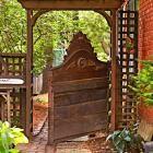 Old headboard as a garden gate!