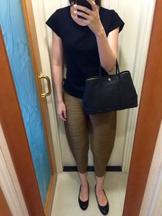 H&M tee, Pleats Please Issey Miyake pants, patent leather flats, Hermes Garden Party TPM.
