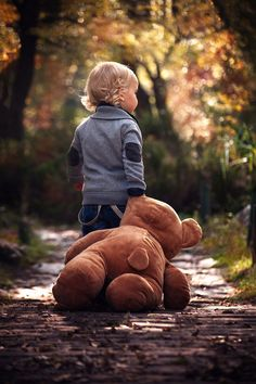 As every season passes, cherish every moment you have with your little ones. This photo is such a quaint reminder of childhood memories during those cozy fall months.