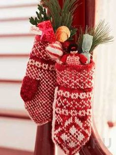 knitted mittens in white and red colors