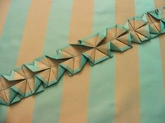 Origami belt-When you open and angle the folds, the stripes in the fabric create a kaleidescopic effect.