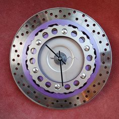 Brake rotor and rear sprocket make for a nice intricate mechanical wall clock in a bikers home. LB