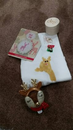I do Christmas Eve and like to have favors.  Ladies get tea towel (target) and I painted reindeer.  Files I believe I got at Walgreen's, box Michaels and used vinyl, earrings Shopko, BBW scented holder, ring Ali-express They are silver dipped in gold very inexpensive $6.74 and no postage for 10.