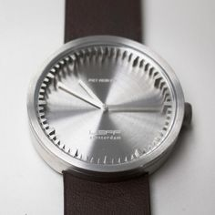 The Tube watch features a 42mm stainless steel case and a brown leather strap #design #watches