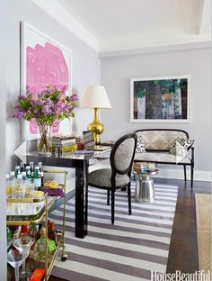 hello, gorgeous // gray walls, pink abstract art, striped rug, bar cart styling, desk inspiration