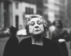 Diane Arbus   Woman on the street with her eyes closed   1956   Photography - Still Life   The work that Diane does makes us question 'what can be art?' for that her work are just pictures of other people.