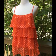 Forever 21 Beautiful Top !  ☀️ Forever 21 orange with cream dots top ! Adjustable straps ! About 26 inches in length ! 4 tiers in front ! Back has elastic and is semi sheer ! 100% polyester ! Wash cold tumble low !  Very pretty !  Forever 21 Tops