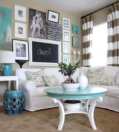 Pretty much love everything about this room from the colors to the grouping on the wall.