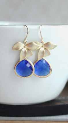 Cobalt Blue Wedding. Orchid Jewelry. Orchid Gold Earrings. Matte Gold Plated Orchid Flower Cobalt Blue Earrings. Bridesmaid Gifts. Modern Flower Blue Earrings. https://www.etsy.com/listing/127946390/a-matte-gold-plated-orchid-flower-cobalt?ref=shop_home_active_12&ga_search_query=cobalt%2Bblue