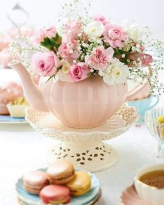 A teapot centerpiece is very appropriate for a tea party. You can find beautiful vintage tea pots in antique stores, flea markets, and garage sales for cheap. Summer Table Decorations, Decoration Table, High Tea Decorations, Afternoon Tea Party Decorations, Garden Decorations, Vintage Party Decorations, Tea Party Bridal Shower, Baby Shower Parties, Tea Party Wedding