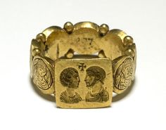 5th century, late Roman. Gold signet-ring composed of a square bezel with angled sides and a hoop constructed of seven small medallions between each of which are two small granules. On the bezel a confronted male and female bust, above them, a cross; the medallions are decorated with alternate male and female busts. in the field to left and right of each bust, a vegetal motif; traces of niello in each medallion.