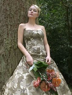 Camo Wedding Dress and Bridal Bouquet Keywords: #weddings #jevelweddingplanning Follow Us: www.jevelweddingplanning.com  www.facebook.com/jevelweddingplanning/