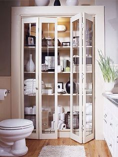 Glass door for linen closet in master bathroom-even with just a single door. Makes all of your pretty towels, ect. visible :)