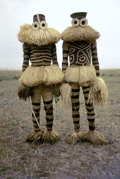Halloween costumes for you and a friend? Minganji masqueraders from the Pende peoples near Gungu, Democratic Republic of Congo,