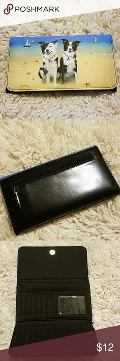 Wallet  with Dogs... Cute wallet with dogs . Has rhinestones. Has place for plenty of cards and checkbook. The clear window where ID goes has black dots....but otherwise the wallet is in great shape. Bags Wallets