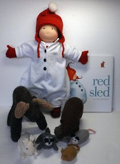 Waldorf boy doll and woodland knitted moose, bear, rabbit, oppossum, mouse, hedgehog and the book Red Sled by Lita Judge