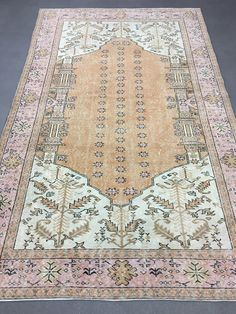 *Vintage Turkish Rug Oushak Rug Distressed Rug Overdyed Rug  *Color: Mute Pink , Mute Orange  *Size: 6.2x10.1ft (188x308cm)  *Design: Distressed, Low Pile  *Material: %100 Wool  *Excellent, Clean And Ready To Use  *Payment: Direct Checkout - Paypal  *Shipping: FREE Shipping! (From Turkey With Fedex&DHL)  We offer %100 refund guarantee in case of any dissatisfaction. In this case buyer will pay the return shipping costs. Please feel free to contact with us. Well be glad to help you...  *It...