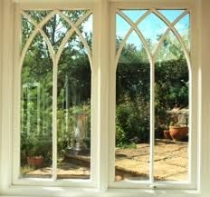 Image result for gothic curved bifold timber doors
