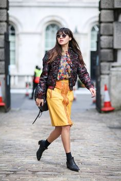 The Most Inspiring Street Style Snaps From London Fashion Week #refinery29 http://www.refinery29.com/london-fashion-week-2014-street-style-photos#slide-19 Mustard leather: surprisingly appealing....