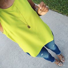 Bright neon yellow tank + Gold tassel necklace + distressed jeans + nude embellished sandals [@tatisbonilla]