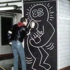 Keith Haring in a NYC subway station.