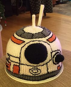 Free knitting pattern for BB-8 Droid Hat Chart - Suzanne Resaul's chart for an 80 stitch hat with the color and embroidery marked on it.