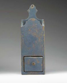 A BLUE-PAINTED WOODEN PIPE BOX  New England, mid-19th century  The rectangular open form with shaped floral form hanging back, fitted with a drawer, appears to retain its original blue paint 15½in. high, 5¼in. wide, 4in. deep    Sold  1795.00    ~♥~